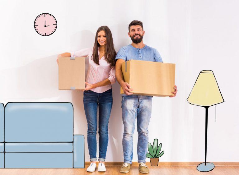 Couple avec boîtes en plein déménagement